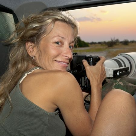 Photographer Jami Tarris photographing out of a game drive vehicle