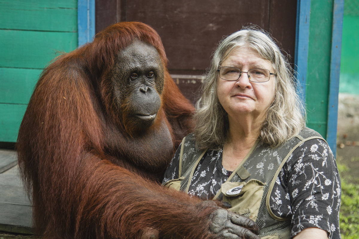 "Portrait of Dr. Birute Mary Galdikas and ""Siswi"" at Camp Leakey in Tanjung Puting National Park"
