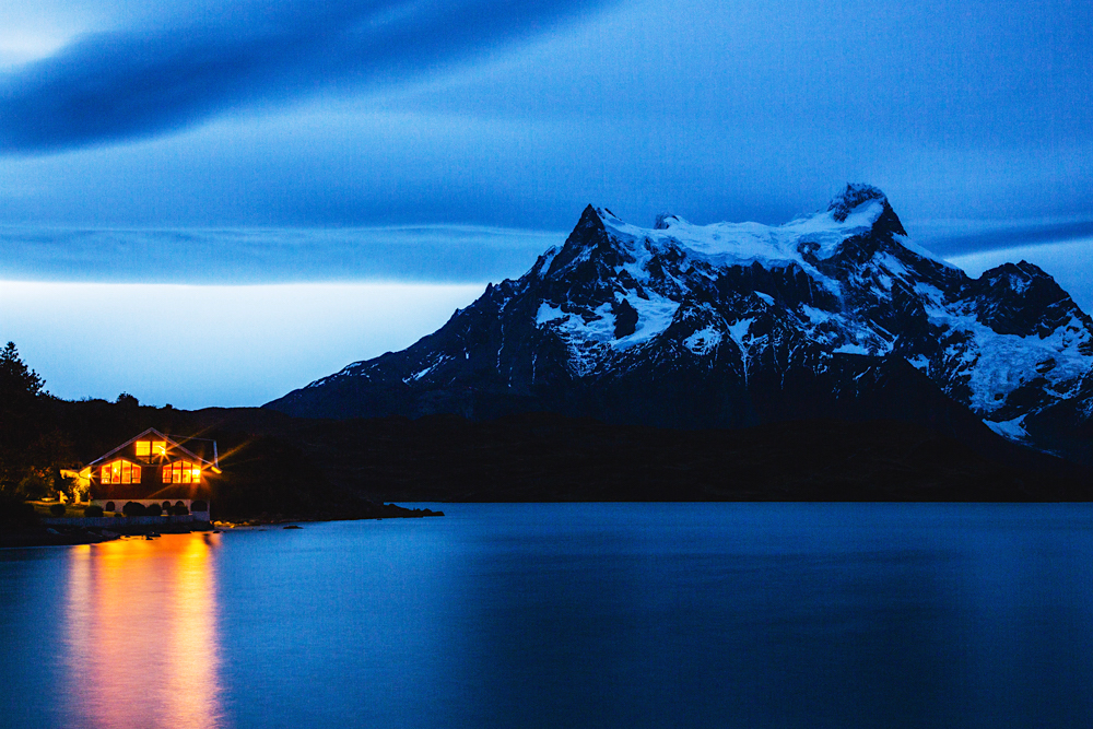A lodge on a lake in Patagonia at dusk