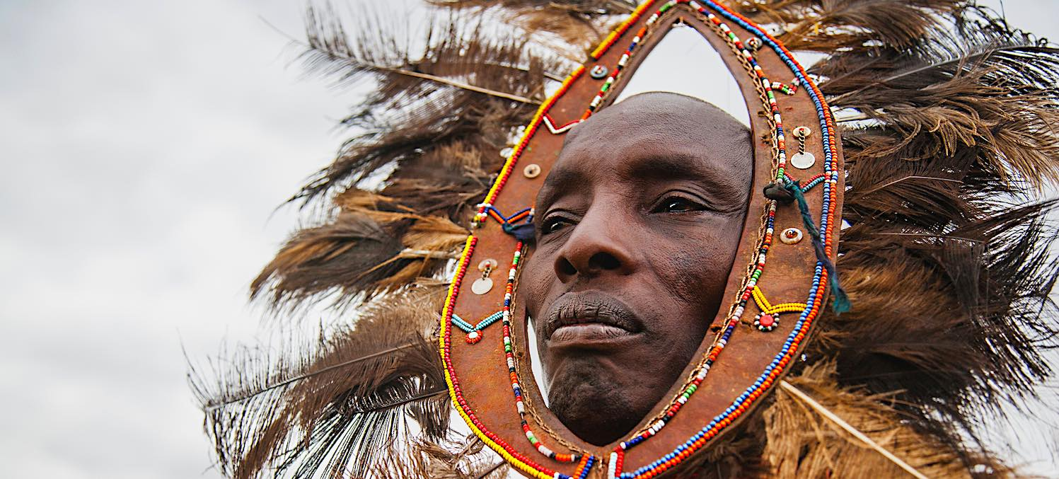 A Maasai chief wearing a shuka and his feather head dress