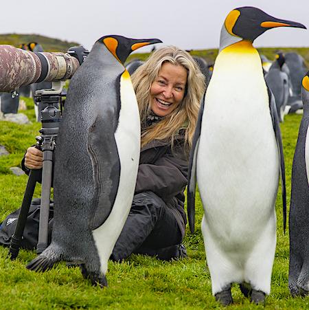Photographer Jami Tarris with king penguis